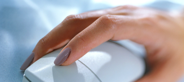 Picture of a woman's hand using a computer mouse.