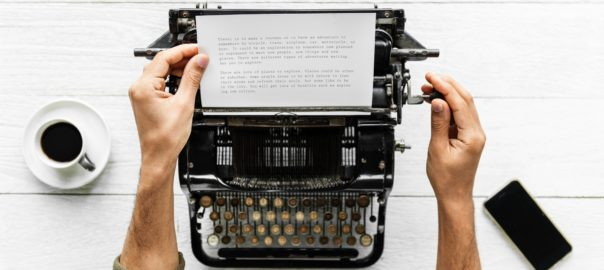 old fashined typewriter and two hands